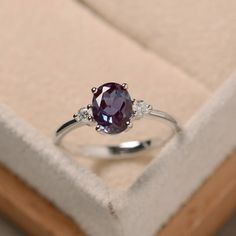 This ring features a 6*8mm oval cut lab alexandrite and sterling silver finished with rhodium. Customization is available. It is made by hand, and it will take about 7 days to finish the ring after your payment is completed. Any question, just let me know. :) My shop homepage: https://www.etsy.com/shop/LuoJewelry?ref=l2-shopheader-name