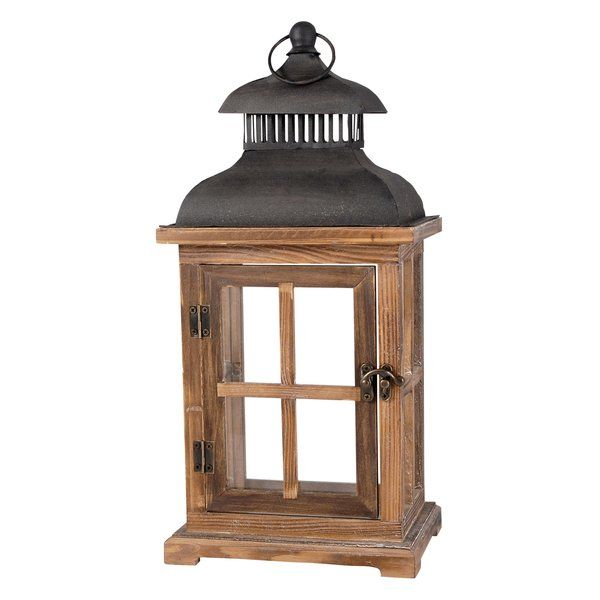 Offer up a rustic touch to your well-curated and on-trend space with this classic lantern, the perfect pick for your lodge-tinged aesthetic. Featuring a clean-lined design awash in brown and black tones, this lantern lends a neutral and earthy touch to your look, while its clear panels let flicker candles shine through in radiant style. Set it on your dining room sideboard to find the right ambience for your next dinner party, or cluster a few in a corner of the den to balance out table…