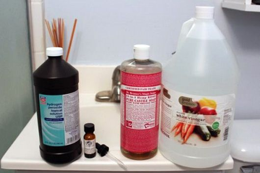 Homemade natural shower spray; hydrogen peroxide, vinegar, castile soap, essential oil