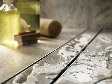 This shower also has a long linear drain from ACO. When you're having a linear drain installed, ask to keep the tile height about 1/16 to 1/8 inch above the drain's edge, so the soap suds and water can fall off the edge of the tile and into the drain ~ http://walkinshowers.org/best-shower-drain-reviews.html