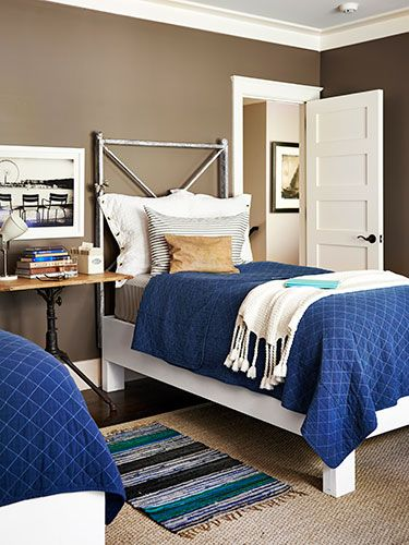 This guest room's headboards are actually salvaged iron gates, attached to platforms from Simply Home.