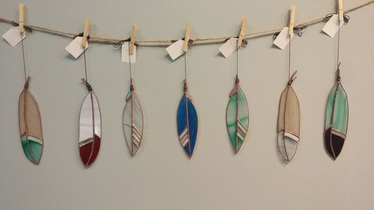 Stained glass feathers by Flux Glass Co. available at Harold + Ferne: The Local Goods Co.