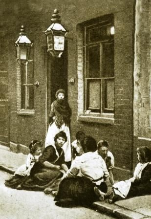This photo is so often used as an example of street life for the victims of Jack the Ripper...outside the Doss houses.  It is one of my favorites though.