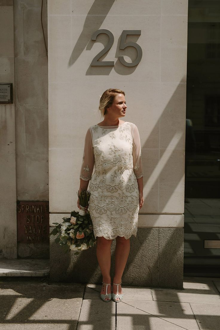 Helaina wore a short, beaded dress from Monsoon for her Westminster wedding. Photography by Emilie White. Helaina and Dan had a larger wedding celebration in France and we'll be sharing those images on Sunday 8th January 2017.