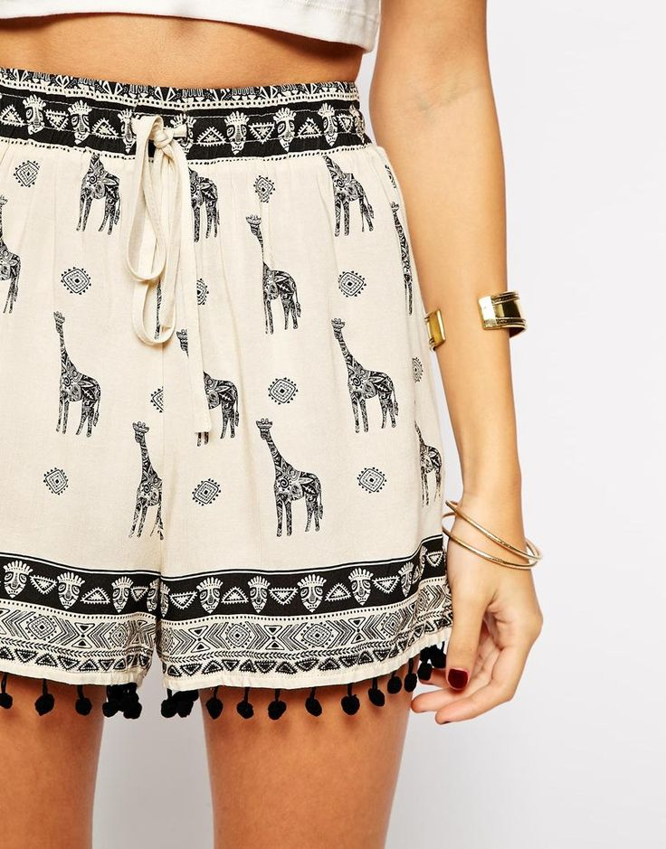 These are really cute!  I like the print, but I think the little tassels would be too much!