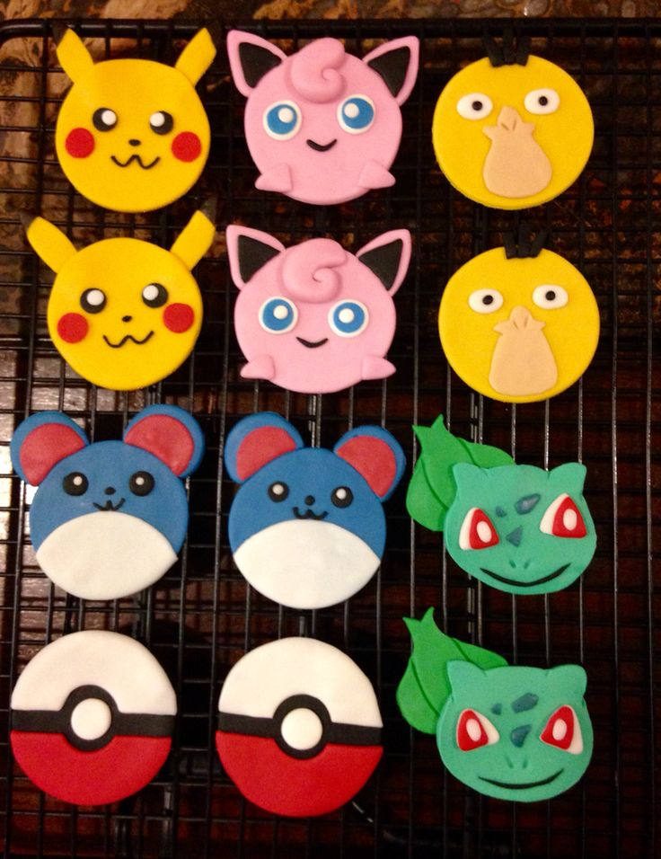 Pokemon cupcake toppers - put an iced sugar cookie on top of a tasty cupcake.