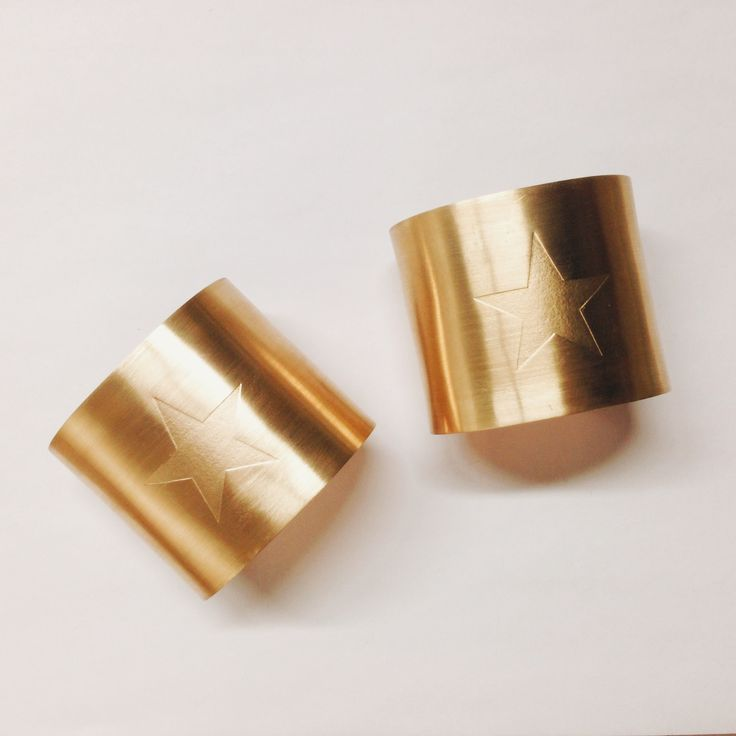 Wonder Woman cuffs - brass with a matte finish star. So. Awesome.