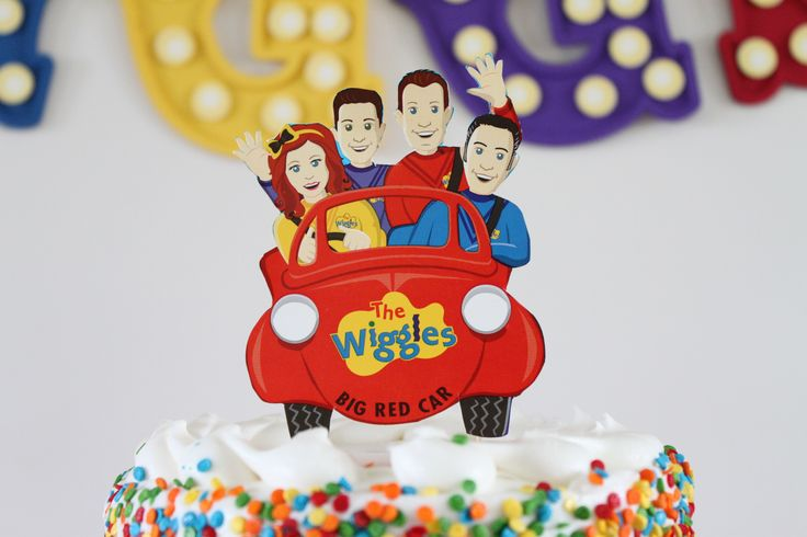 A pair of scissors and a little bit of time is all you need to transform a Wiggles Dinner Plate or spare party invitation into a custom cake topper for your little one's rocking Wiggles birthday party. (Credit: Jenny)