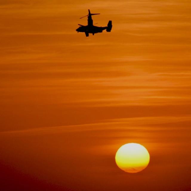Osprey V22 flying into sunset