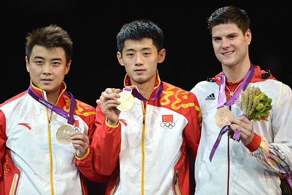 Gold: Zhang Jike (center, China)Silver: Wang Hao (left, China)  Bronze: Dimitrij Ovtcharov (Germany)  in Table Tennis - Men's singles