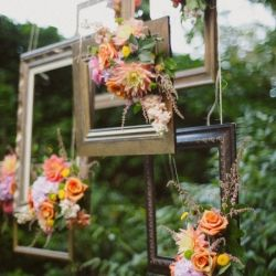 Incredible floral + picture frame ceremony backdrop in this Seattle wedding from One Love Photography!