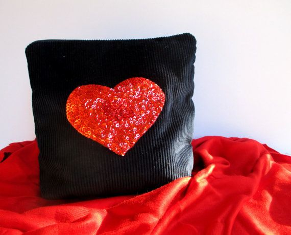 Red heart hand embroidered with red seed beads and by Apopsis