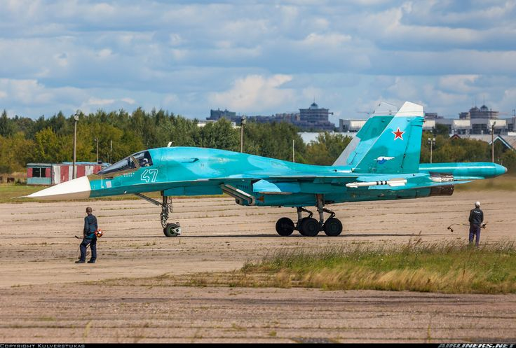 Russian Air Force Sukhoi Su-34 (Su-32FN)  47 / 47 blue Lawnmowers, who prepares runways and taxiways for MAKS-2015 staring at Big Blue Bird just returned from test flight.