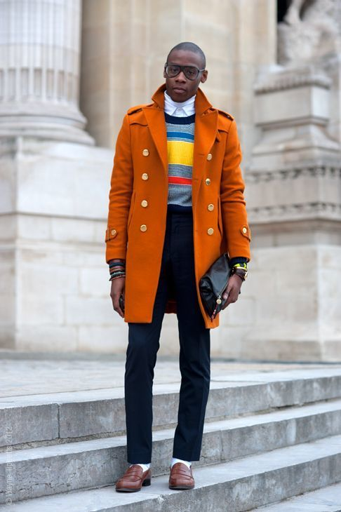 Perfect the smart casual look in an orange overcoat and navy casual pants. A pair of brown leather loafers will seamlessly integrate within a variety of outfits.   Shop this look on Lookastic: https://lookastic.com/men/looks/overcoat-crew-neck-sweater-turtleneck/23972   — White Turtleneck  — White Dress Shirt  — Multi colored Horizontal Striped Crew-neck Sweater  — Orange Overcoat  — Brown Bracelet  — Navy Chinos  — Black Leather Zip Pouch  — White Socks  — Brown Leather Loafers