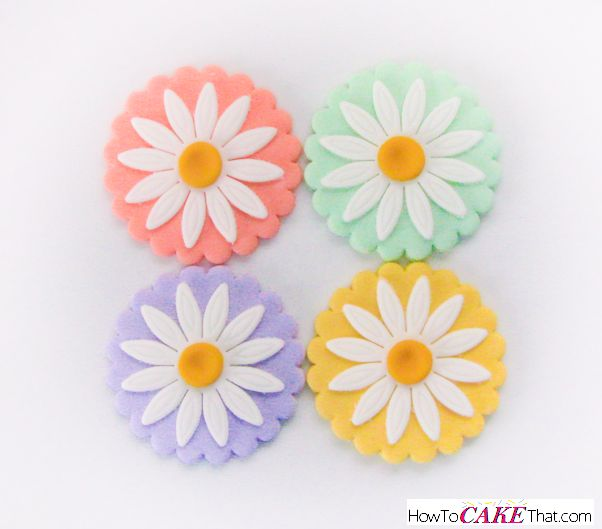 Pastel Daisy Fondant Cupcake Toppers! How cute are these?! Learn how to make these super quick and easy toppers in this photo tutorial!