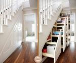 Here's yet another great way to use that under stair space.