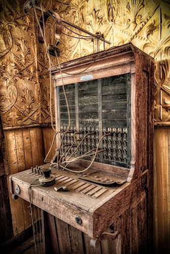 An old switchboard sits unused in an abandoned, haunted hotel in Bodie, California.