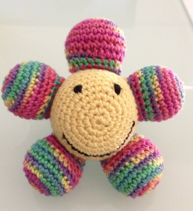 Crochet Flower Soft Toy - by HookedupbyAnge on madeit [www.madeit.com.au...] - Love this also, would be even cooler with a rattle inside!