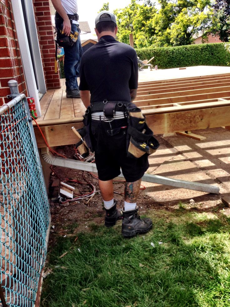 Evan cutting and Chad setting deck boards 15 Aug 14