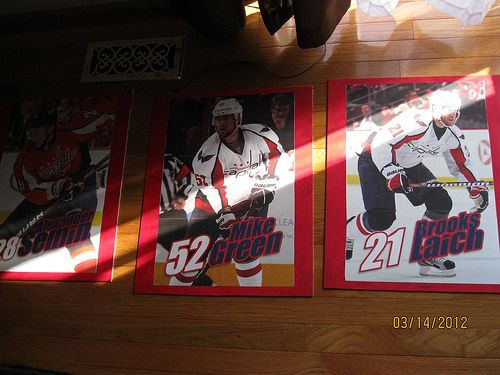Hockey posters attached to canvas boards, for the boys' room