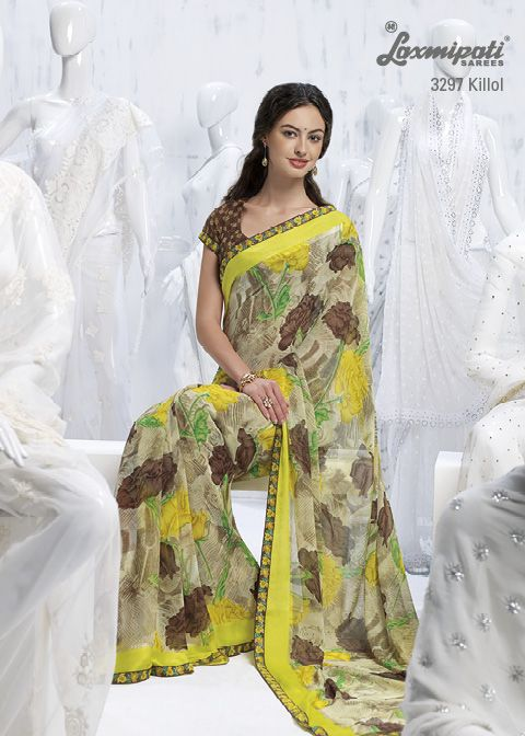 Contrast brown raw silk blouse is truly complimentary this beautiful lemon yellow printed saree.