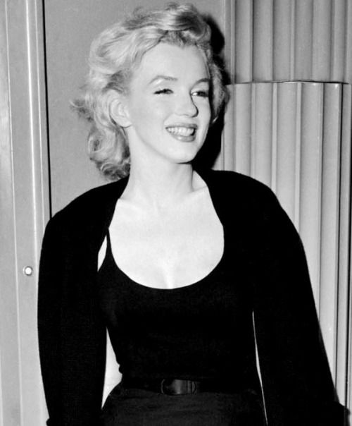 """Marilyn Monroe at a press conference where she discussed her upcoming marriage to Arthur Miller, 1956. """