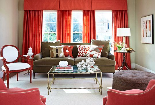 High-gloss finishes and striking red keep this room vibrant day and night. - Traditional Home®