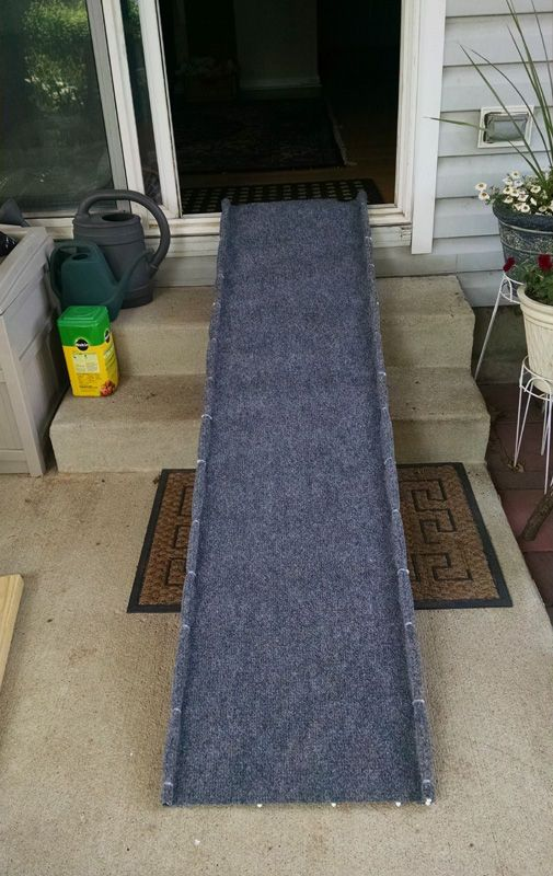 """A PET RAMP FOR BOO Pet ramps are expensive! I looked at the cost of these things and thought that $100.00 to $180.00 was too much to pay so I thought that I'd design my own with common items found at Home Depot. My intention was to be able to use the ramp to get our Shar-Pei, Buster (otherwise known as """"Boo"""") in and out of our pickup truck so that he could have some relief from his tennis elbow and not have to deal with the constant impact on his joints. My dog is a darned good tenn..."""