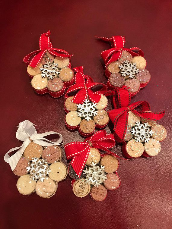 These snowflake ornaments are made from upcycled wine corks. They come in sets of 3, and all 3 will look like the one pictured. These are sturdy and held together with glue and surrounded by glued-on ribbon. These ornaments look beautiful on the tree as the iridescent glitter catches the