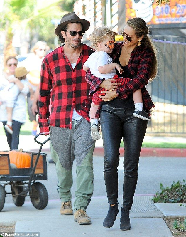 Elizabeth Berkley and Greg Lauren . . . Lumperjack Laurens: Elizabeth Berkley, 42, dressed her hunky husband Greg Lauren and adorable little boy Sky Cole for an all-matching trip to the pumpkin patch on Sunday.