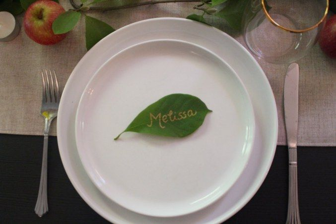 Fall place settings. Use gold marker to write your guests names on green leaves. White plates and everyday cutlery keep this tablescape simple yet sophisticated.   Place setting | Fall Tablescape | Fall Dinner Party | Fall Menu | Fall | Casual | Classic | Season And Serve Blog