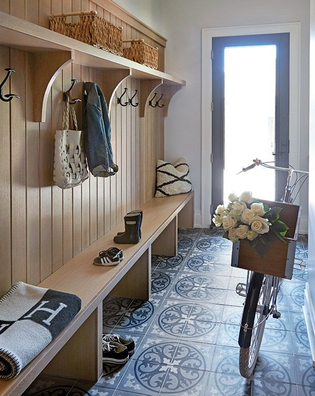 Add Hanging Storage An essential component in any mudroom or entryway is having plenty of space hang things; if you don't have enough, things can get cluttered fast. I like how Calgary designer Nam Dang-Mitchell mounted pairs of metal hooks between the brackets on this wooden built-in, creating designated spots for each member of the family.