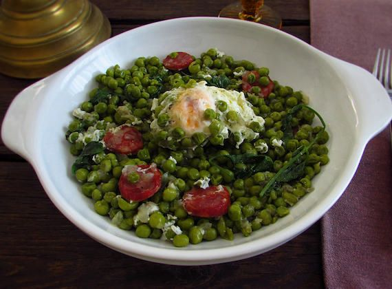 Peas with poached eggs and chorizo   Food From Portugal. A very tasty and nutritious recipe, peas cooked in olive oil, chopped onion, garlics, bay leaf and chorizo, served with poached eggs, sprinkled with coriander.  http://www.foodfromportugal.com/recipe/peas-poached-eggs-chorizo/