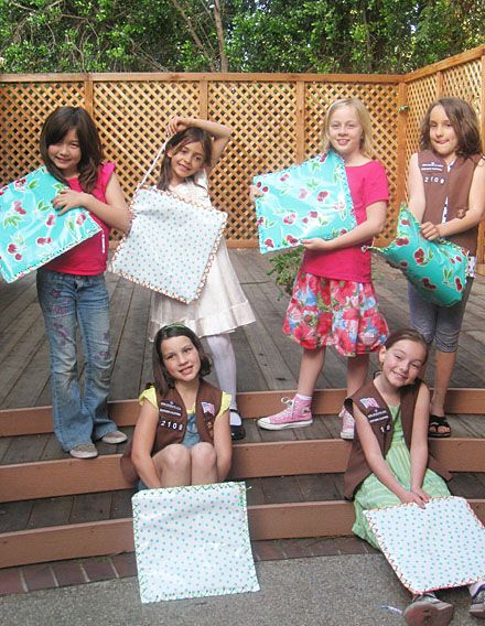 """""""Sit-Upon""""—a Girl Scout tradition! You take a rectangle piece of oilcloth or vinyl and put newspaper or other padding in it. Punch holes around the edge and """"sew"""" it up with contrasting yarn or rope. Attach a strap for your waist. When your hiking this thing hangs over your butt so when you sit down it is always dry, warm, and a little padded."""