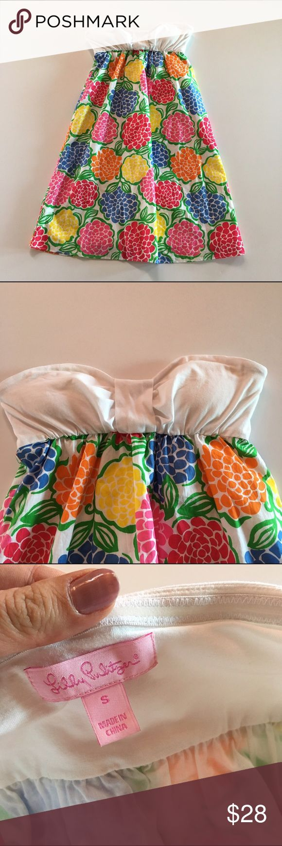 Lilly Pulitzer floral and white bandeau dress In great used condition, this cute bandeau dress is cotton and light, bright and perfect for summer or a vacation! Size small. Bust 29, length 28.5. Very tiny discoloration spot on top see photo. Lilly Pulitzer Dresses Mini
