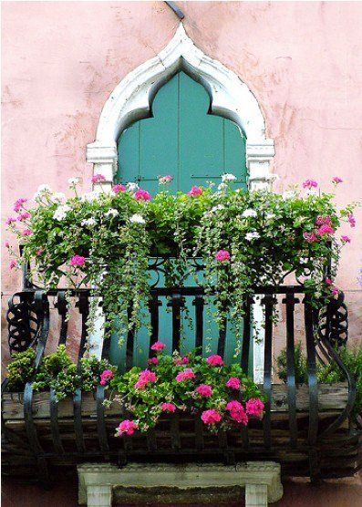 Venice balcony with flowers - Now all we need is Juliette looking down at Romeo.