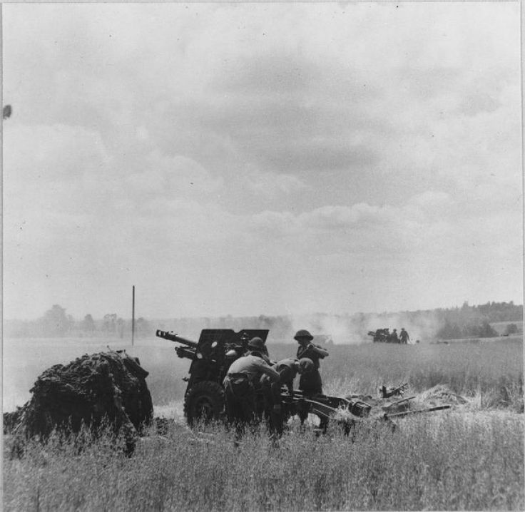British 25-pdr field guns in action during an attack on Tilly-sur-Seulles, 17 June 1944