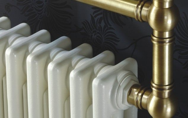 Traditional bathroom radiators with an antique brass finish.  Talk to Simply Radiators for more information.