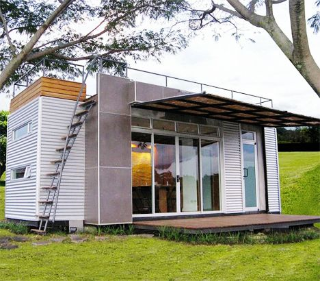 Tiny Glass-Walled Container Home Features Rooftop Deck