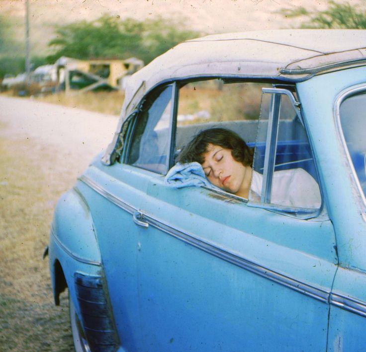 Young girl sleeping in car, Hawaii, ca. 1950s