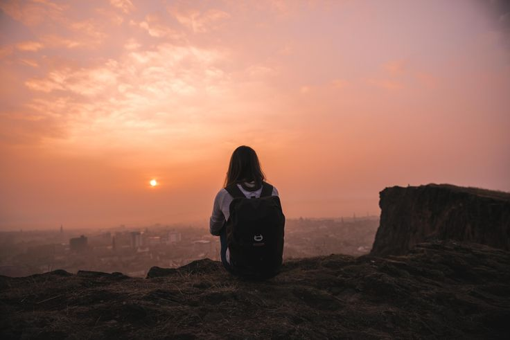 Kate Johnston watching the sun go down over Edinburgh with her Arkaig Backpack.