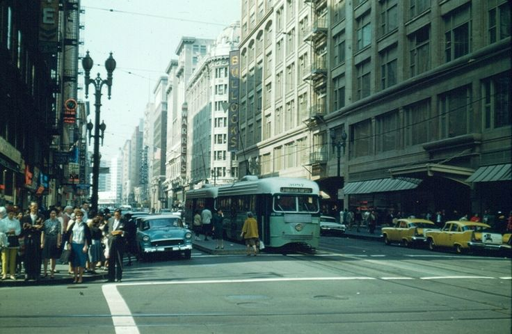Looking west on 7th Street from Broadway, 1963   Los Angeles Metropolitan Transit Authority Line J eastbound at Seventh Street and Broadway on February 10, 1963. Photographed by Alan Weeks.  Metro Transportation Library and Archive