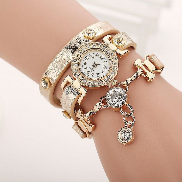 Gold-tone round watch featuring crystal-set bezel and studded wraparound glittery faux leather band Quartz movement with analog display Protective glass crystal dial window Not water-resistant Band le