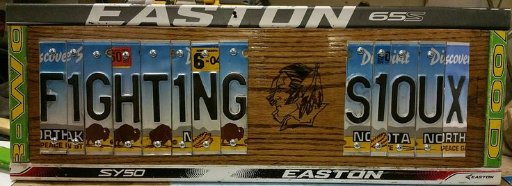 My first ever crafty thing! Fighting Sioux Sign, made with cut up license plates, wood burned the logo and used old hockey sticks for the frame.