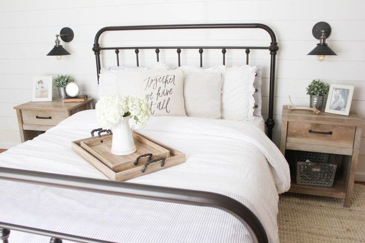 Farmhouse master bedroom with metal bed frame and Sauder Cannery Bridge nightstand