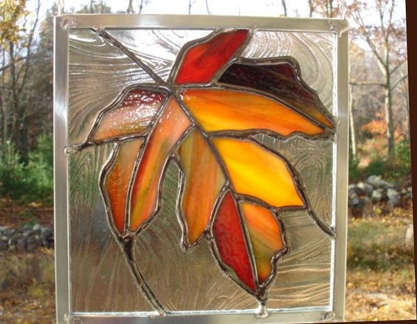 Maple leaf stained glass panel, orange, red, yellow. $30.00, via Etsy.