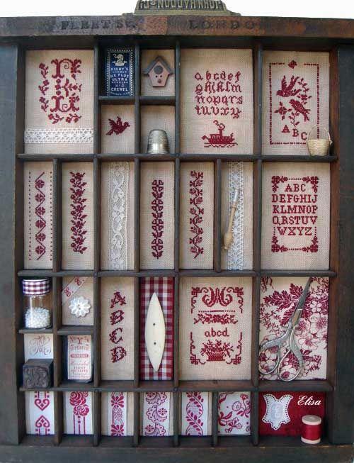 Vintage letterpress drawer with redwork cross stitch inserts