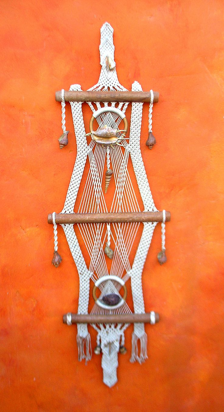 I would probably replace the shells with something else, but i love the geometric design of this - Vintage 1960s 1970s LARGE Macrame wall hanging  $75.00, via Etsy.
