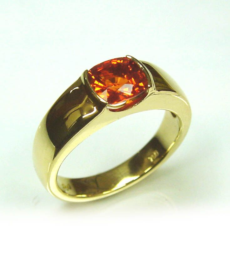 Chibnalls custom made ring using our clients own gemstone a vibrant fancy orange Sapphire.