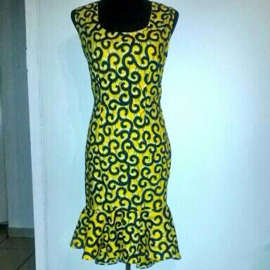 African print,yellow shift dress with flared detail.